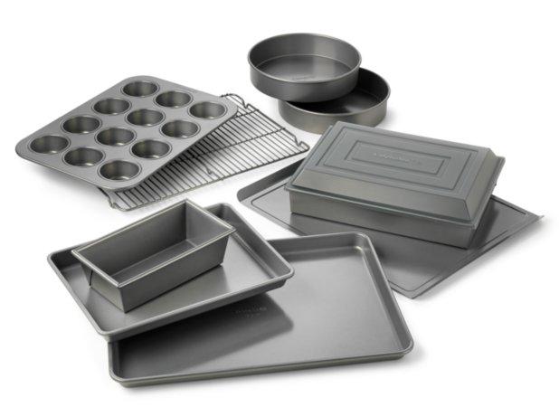 Calphalon Nonstick Bakeware 10-Pc. Bakeware Set including muffin pan, baking sheet, loaf pan, round cake pan, cookie sheet, brownie pan, covered cake pan and cooling rack.
