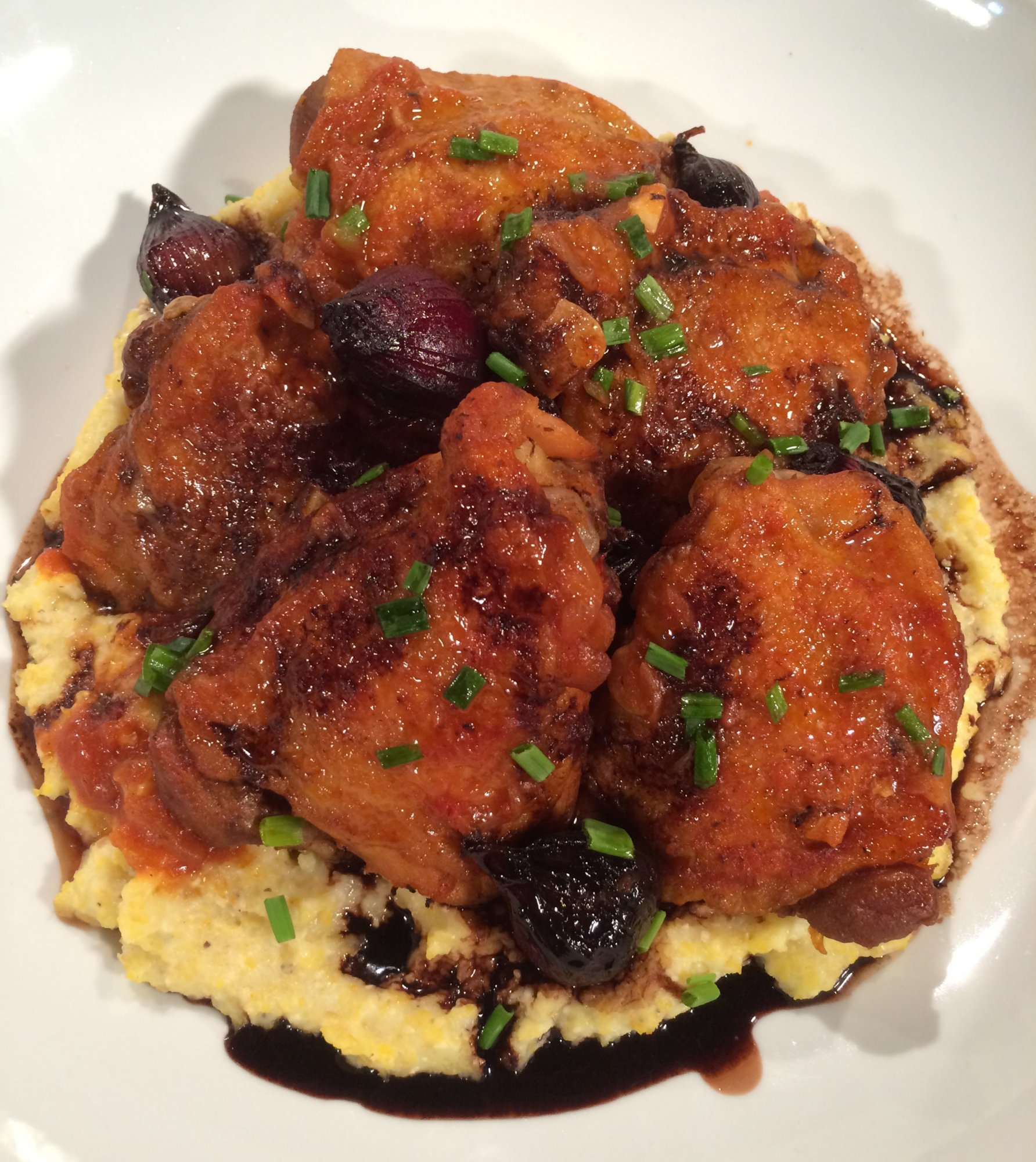 Braised Chicken Thighs with Fontina Polenta and Balsamic Onions